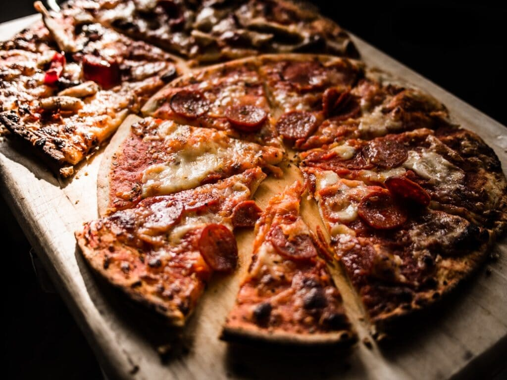 pizza-on-brown-wooden-board